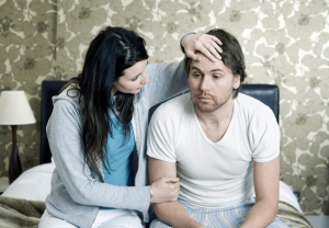 a man feeling ill after EMF exposure